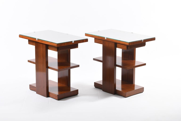 Pair of rectangular tables with three shelves and one-drawer positioned under the top which opens on both short sides. the upper floor is protected by a ground glass. France, 1930s Art Deco.