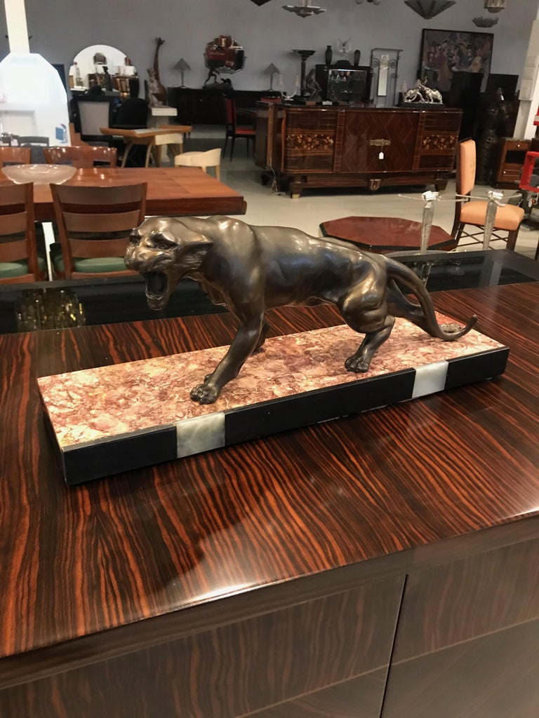 Art Deco panther sculpture mounted to marble base.