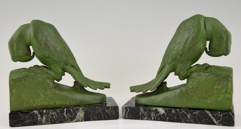 Patinated Art Deco parrot bookends by Georges Van de Voorde France 1925 For Sale