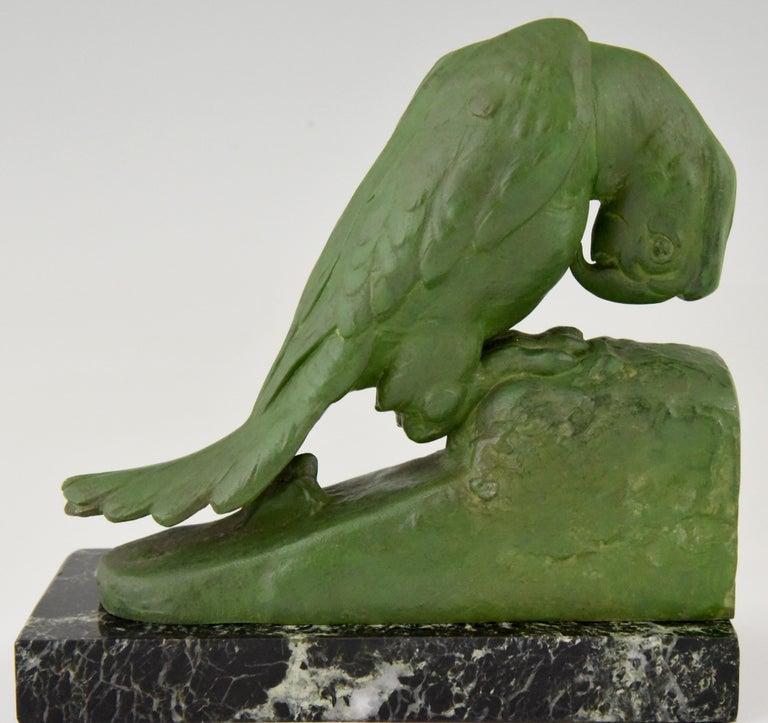 Metal Art Deco parrot bookends by Georges Van de Voorde France 1925 For Sale