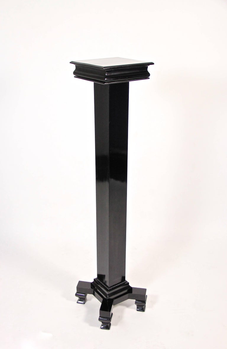 This stunning Art Deco pedestal from circa 1920 was made in Austria of fine fruitwood. Ebonized and finished with a fantastic hand-polished shellac finish, this Pedestal impresses with its straight architectural design. Reduced to clear lines,