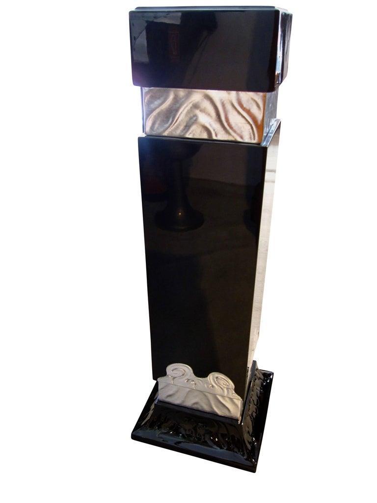 Very elegant, quadratic Art Deco Pedestal with silver-plated flower tendrills. Underneath, the wood is walnut, which has been lacquered and polished in a shiny high-gloss black, making it appear very precious. At the bottom, there are ornaments on