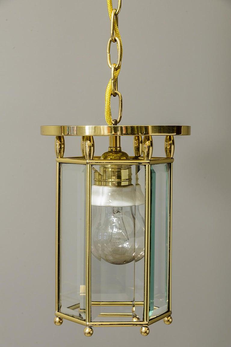 Art Deco pendant, circa 1920s Polished and stove enamelled Cut glasses.