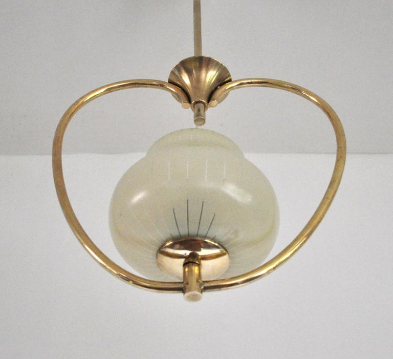 Brass and etched glass Art Deco pendant light with the original canopy.