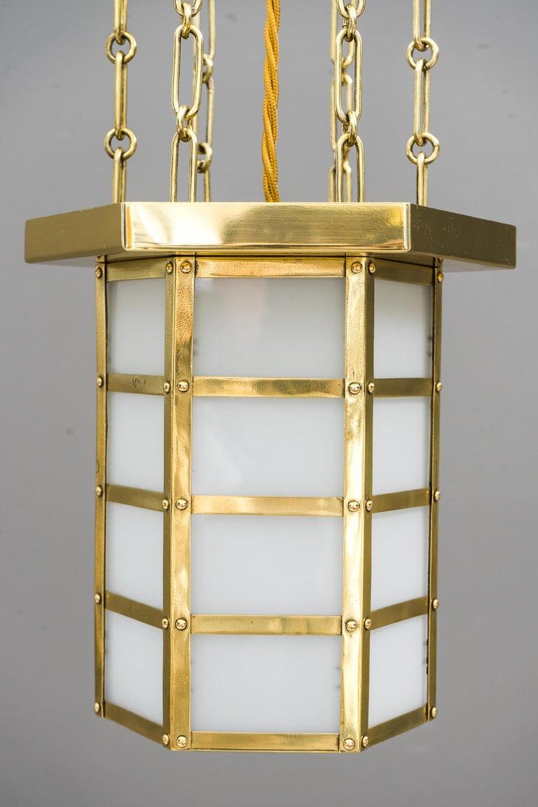 Art Deco pendant, Vienna, circa 1920s Brass polished and stove enameled Original opal glasses.
