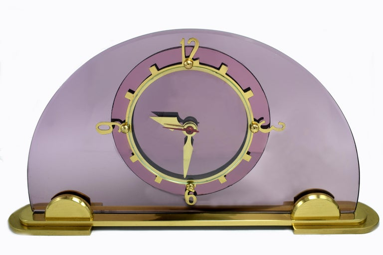 Original 1930's pink / lilac glass clock by the English clock makers Smiths. Beautiful coloured dial face which sits of a solid highly polished brass plinth with brass numerals and accents. Fabulous condition, full working order. ( We can provide a