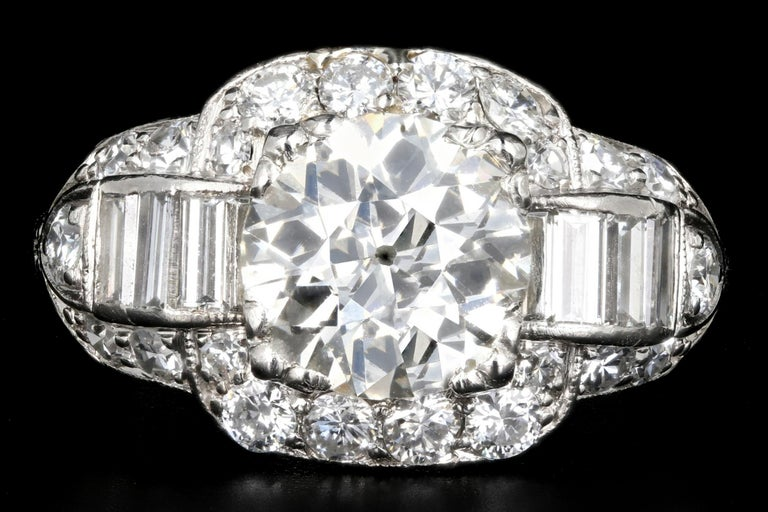 Era: Art Deco  Composition: Platinum  Primary Stone: Old European Cut Diamond  Carat Weight: 1.75 carats  Color: K  Clarity: Vs1  Accent Stone: Baguette and Old European Cut Diamonds  Carat Weight: Approximately 1 Carat  Total Carat Weight: