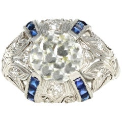 Art Deco Platinum 2 Carat Old European Cut Diamond and Sapphires Engagement Ring