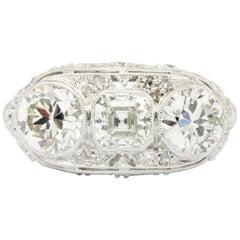 Art Deco Platinum 3-Stone Diamond Engagement Ring, circa 1930s