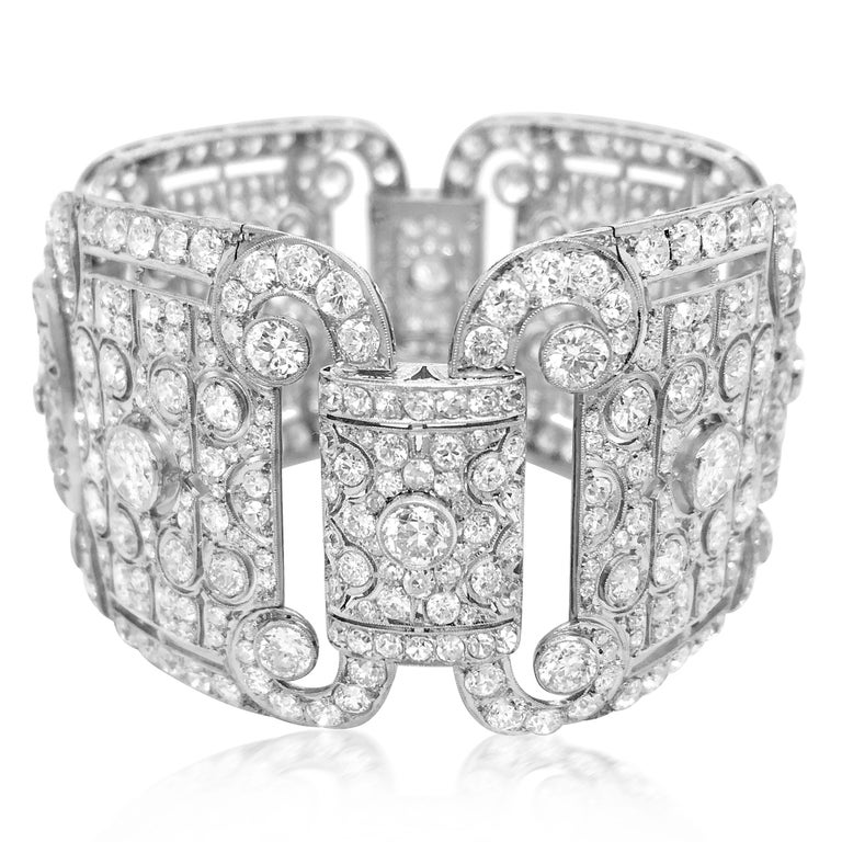 This captivating antique diamond link bracelet characterizing the most elegant wrist ornament is crafted in solid platinum, weighs 89.12 grams and measures 18cm (7.08 inches) long and 40mm (1.57 inches) wide. It incorporates four quintessentially