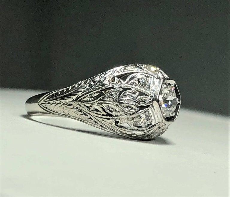 Art Deco Platinum and 18 Karat Gold European Cut Diamond Dome Engagement Ring For Sale 6