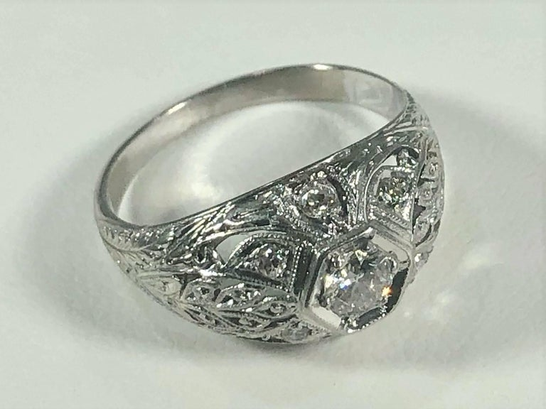 Art Deco Platinum and 18 Karat Gold European Cut Diamond Dome Engagement Ring For Sale 7