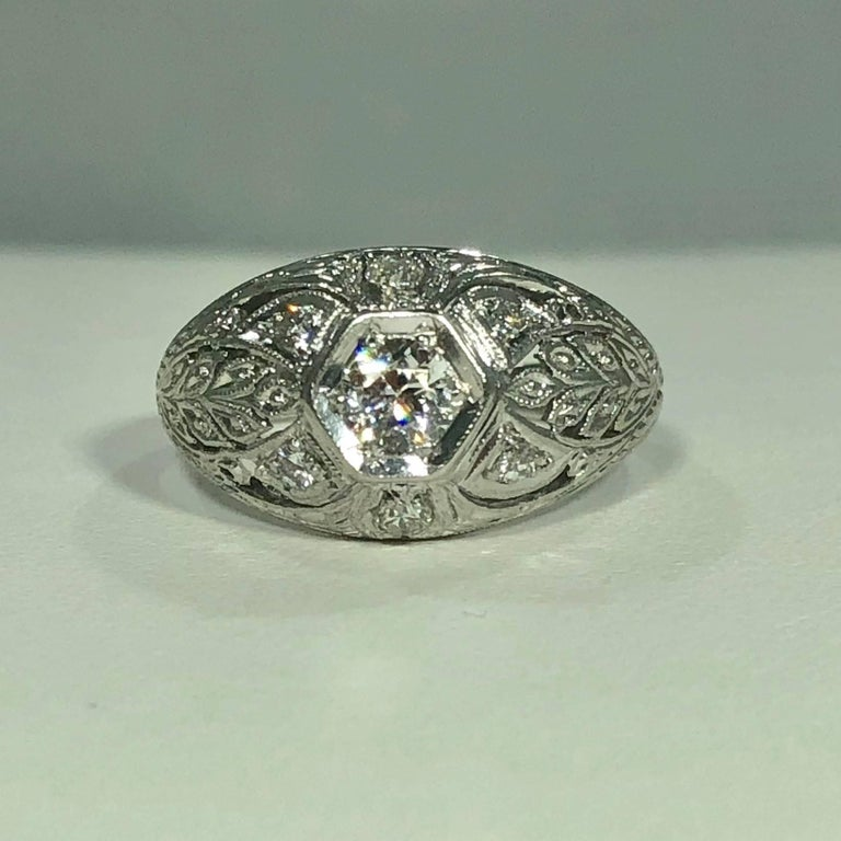 Art Deco Platinum and 18 karat European cut diamond dome engagement ring. This true Art Deco piece is stunning. Created in Platinum and 18 karat white gold with exquisite filigree detail. The center stone is a European cut diamond .25 carat approx.,