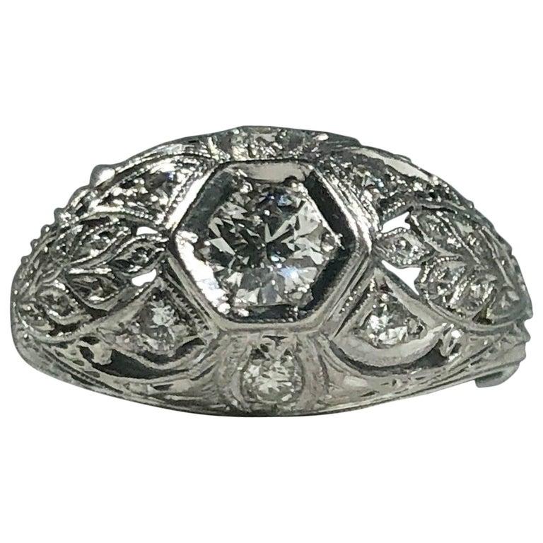 Art Deco Platinum and 18 Karat Gold European Cut Diamond Dome Engagement Ring For Sale