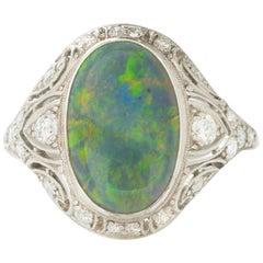 Art Deco Platinum and Diamond and 2.8 Carat Black Opal Ring