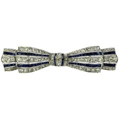 Art Deco Platinum Bow Tie Brooch with Diamonds and Sapphires, France, circa 1920