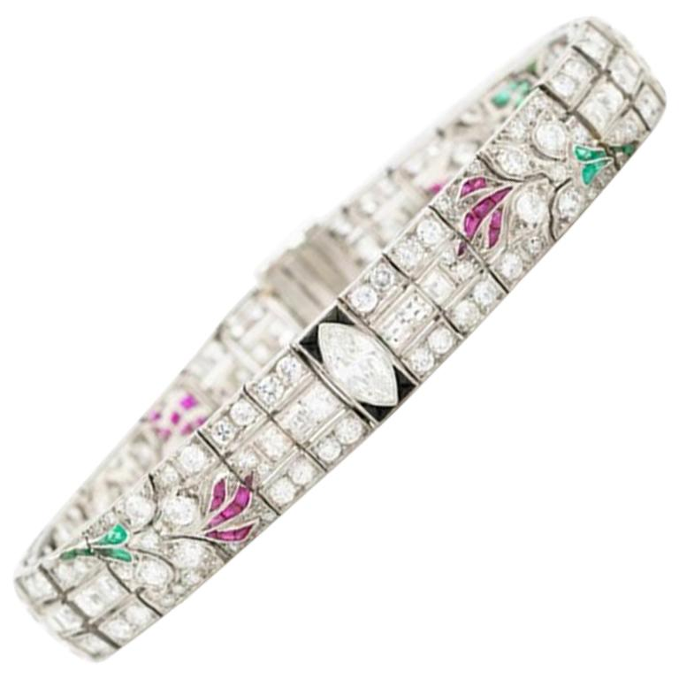Art Deco Platinum Carre Cut Diamond and Colombian Emerald, Onyx and Ruby For Sale