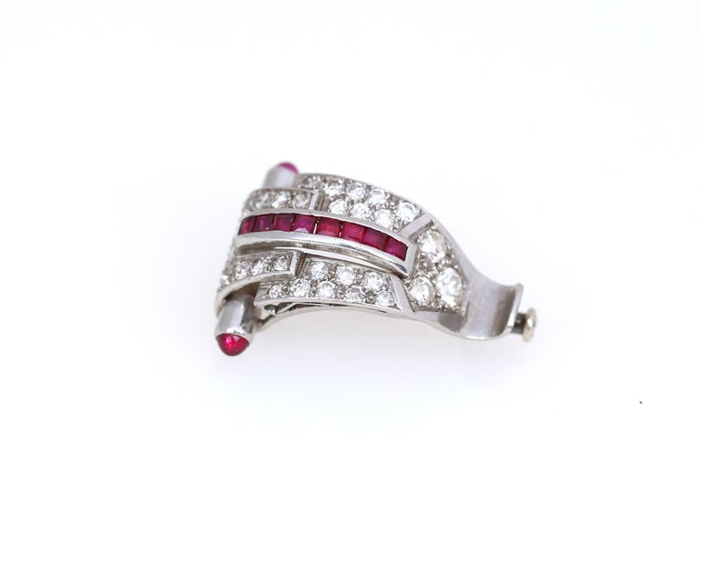 Superb example of the Art Deco style. Fine craftsmanship of invisible cast of Rubies in one line. A cabochon shaped Rubies. 1920.   A delicate and fine item both for ware and collection!  Total Diamond Weight: 1.35 Ct.  Weight: 6 gr Height: 25 mm
