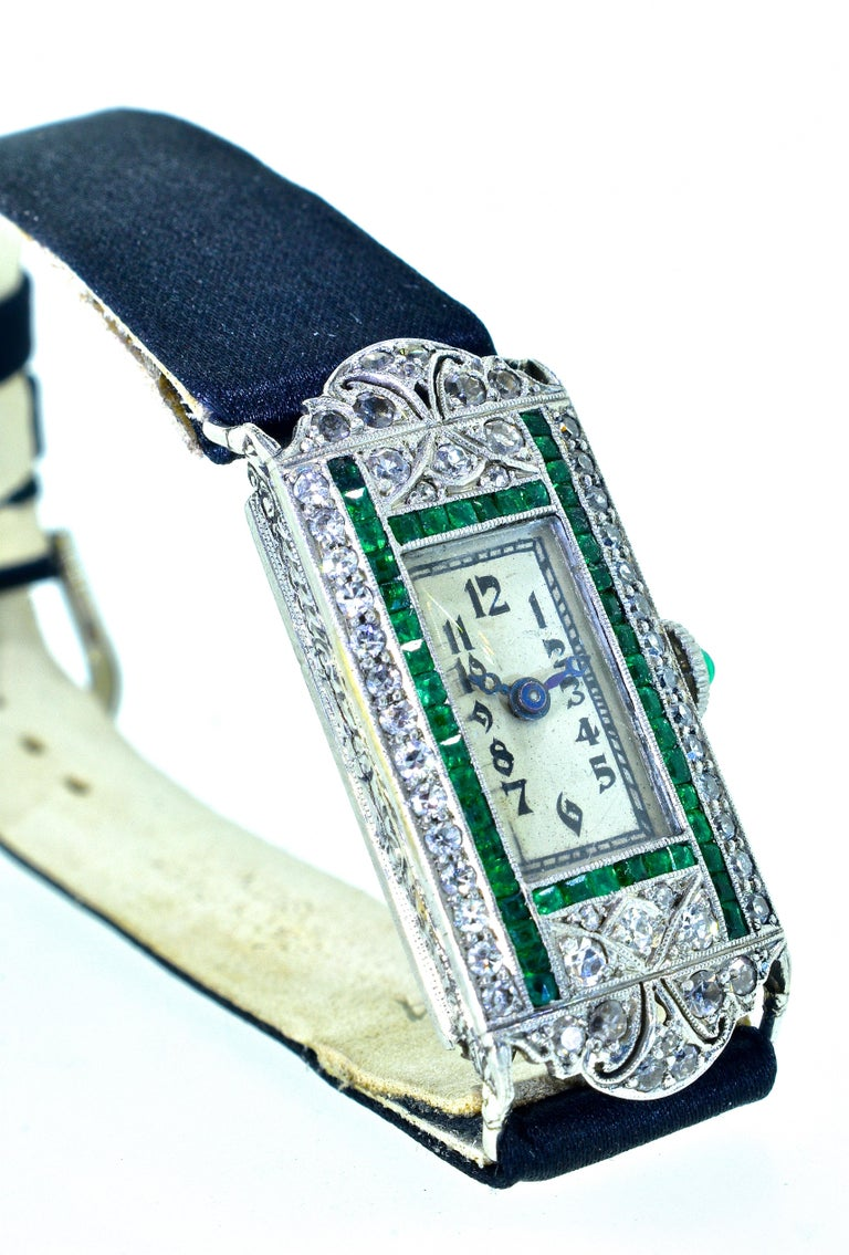 Emerald Cut Art Deco Platinum, Diamond and Emerald Wristwatch, circa 1920 For Sale