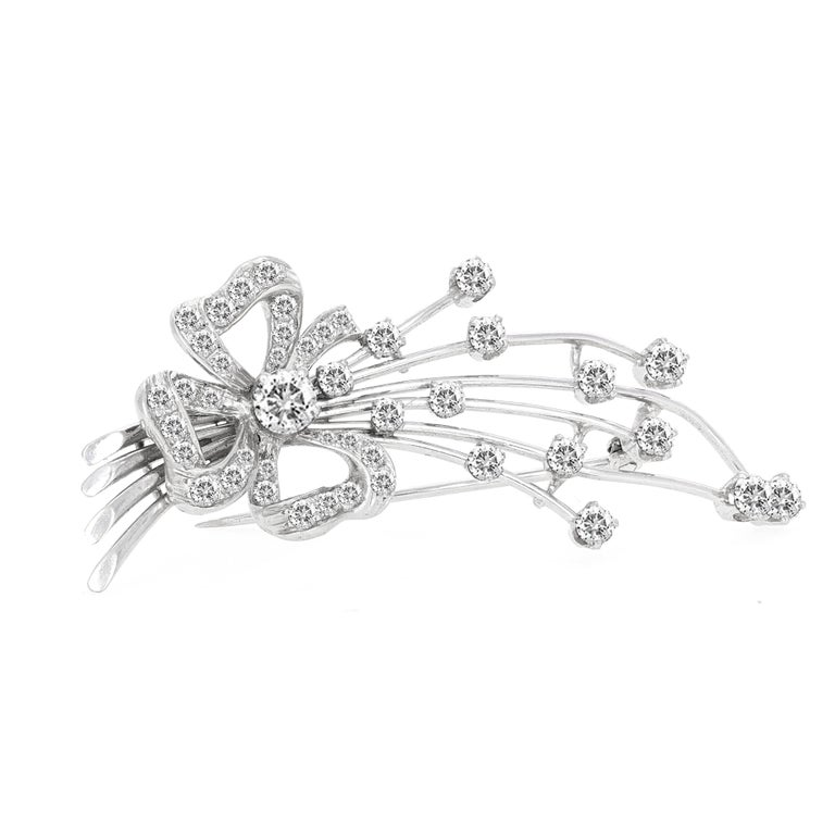 Art Deco platinum diamond brooch. The brooch is made with 43 round diamonds that are white in color and eye clean. The 43 diamonds weigh a total estimated diamond weight of 1.70 carats.
