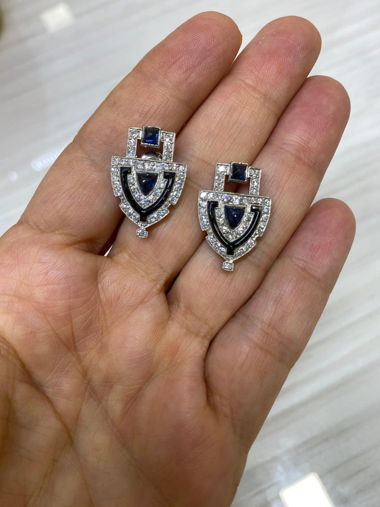 Sugarloaf sapphires surrounded by 74 old European and single cut diamonds trimmed with black onyx scream Art Deco!  Approximately 0.80 CTW Diamonds  Approximately 0.75 CTW Sugarloaf Sapphires  13/16 inch length  7.72 grams (gross) New Post backs