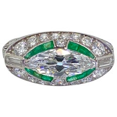 Art Deco Platinum East West Marquise Cut Diamond and Emerald Ring