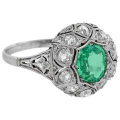 Art Deco Platinum Emerald and Diamond Ring 1 Carat Center