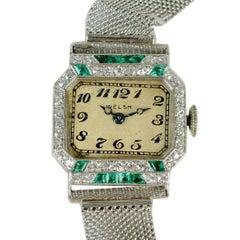 Art Deco Platinum Emerald and Diamond Wristwatch Signed 'Welch', c1925