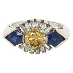 Art Deco Platinum, Fancy Colored Diamond, Diamond and Sapphire Ring