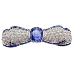 Art Deco Platinum, Natural Unheated Sapphire and Honeycomb Diamond Bow Brooch