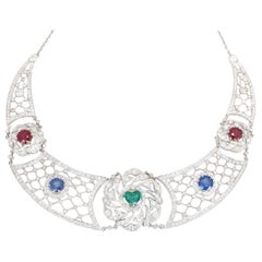 Art Deco Platinum Necklace Heart-Shaped Emerald Sapphires Rubies Diamond
