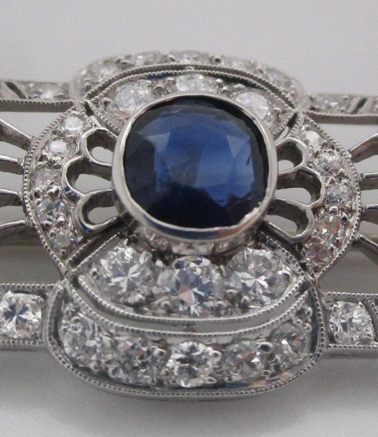 Round Cut Art Deco Platinum No Heat Blue Sapphire and Diamond Architectural Bar Pin For Sale
