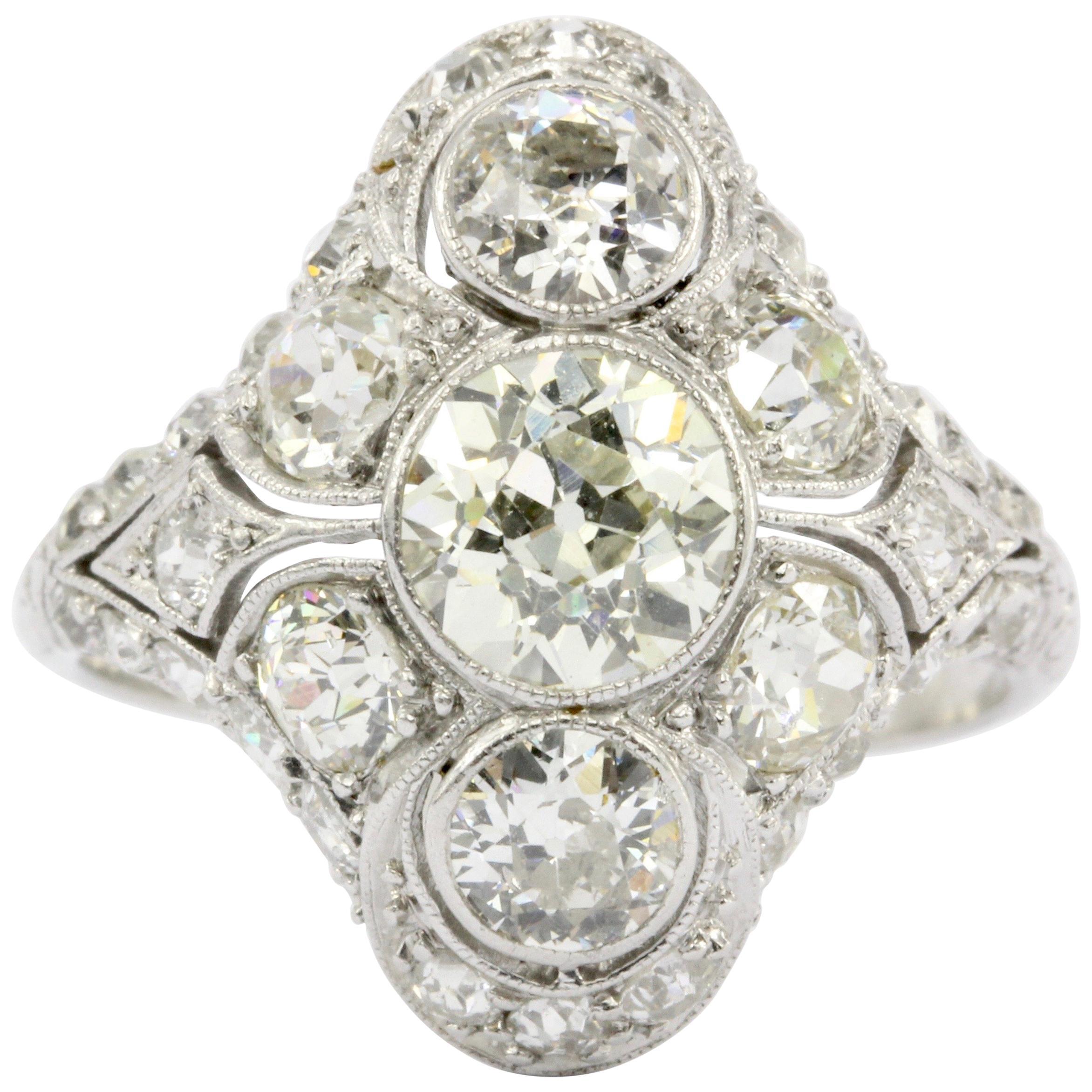 Art Deco Platinum Old European Cut Diamond Three-Stone Cluster Ring, circa 1920s