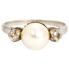 Art Deco Platinum Pearl and Diamond Three-Stone Ring