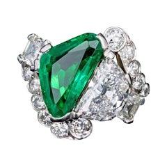 Art Deco Platinum Triangular Cut Columbian Emerald & Half Moon Cut Diamond Ring