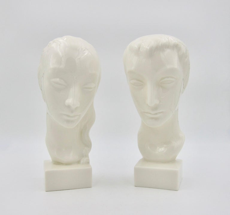 An American Art Deco bust pair designed by Geza de Vegh (1905-1989) for Lenox (formerly the Ceramic Art Company) of Trenton, New Jersey, dating circa 1930s. The stylized portrait busts of a man and woman were designed with delicate features and
