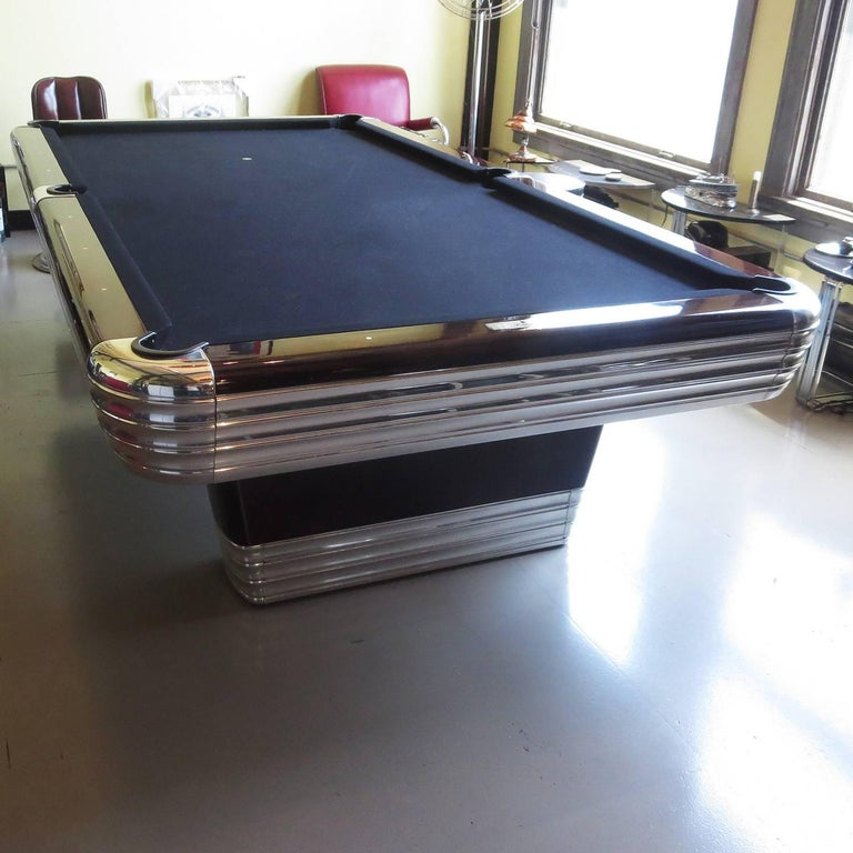 Although the Brunswick Company made many styles and models of pool tables, the early streamlined models are among the rarest tables. The Centennial was made of the highest quality Brazilian rosewood rails and a solid cast aluminum skirt and base.