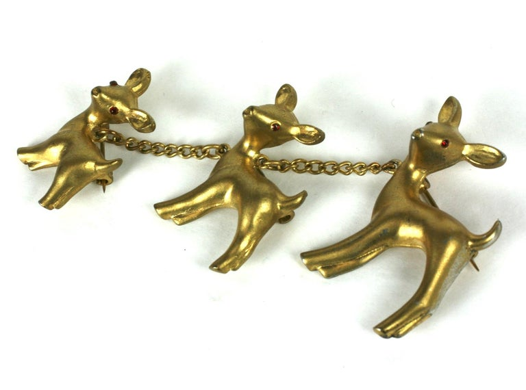 Charming Gold toned Chanel Multi Deer Brooch from the 1930's. Entire deer family is attached by chains, each with its own pin fitting and ruby crystal eyes.  Although this is NOT a creation or design from the house of Chanel, Paris, this licensed