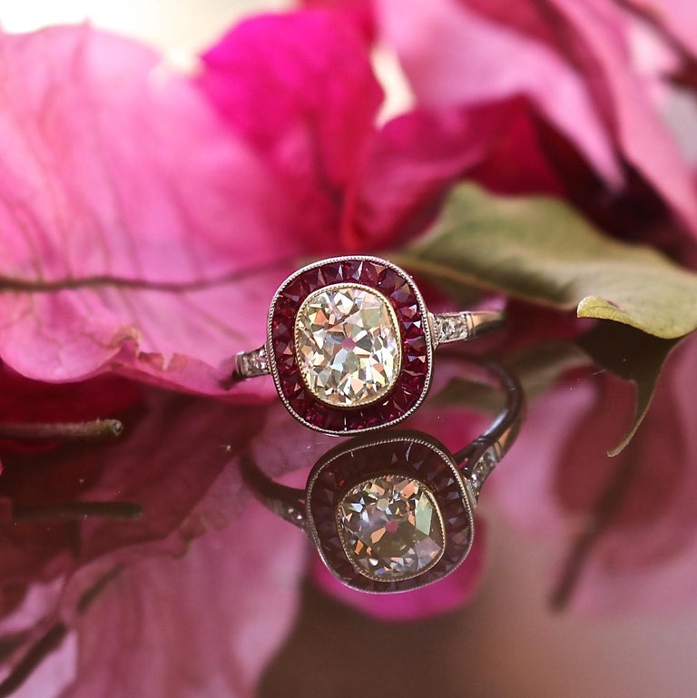 Rubies and diamond are always a winning combination. Add a 1.44 old mine cut diamond and perfectly cut French cut rubies and you have this gorgeous engagement ring with endless sparkle. The old mine cut is graded L-M color, VS clarity, and the 24