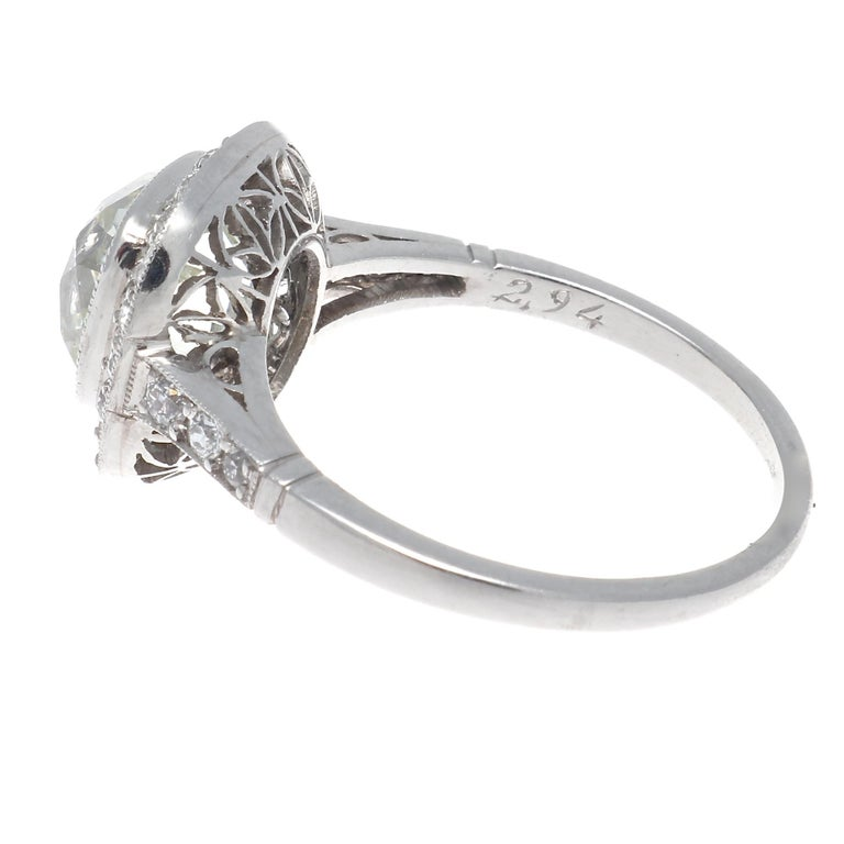 Timeless design that is a symbol of eternal love. Featuring a 2.94 carat old mine cut diamond that is K color, VS1 clarity surrounded by a halo of numerous near colorless diamonds. Hand crafted in platinum. Ring size 6-1/2 and can easily be resized,