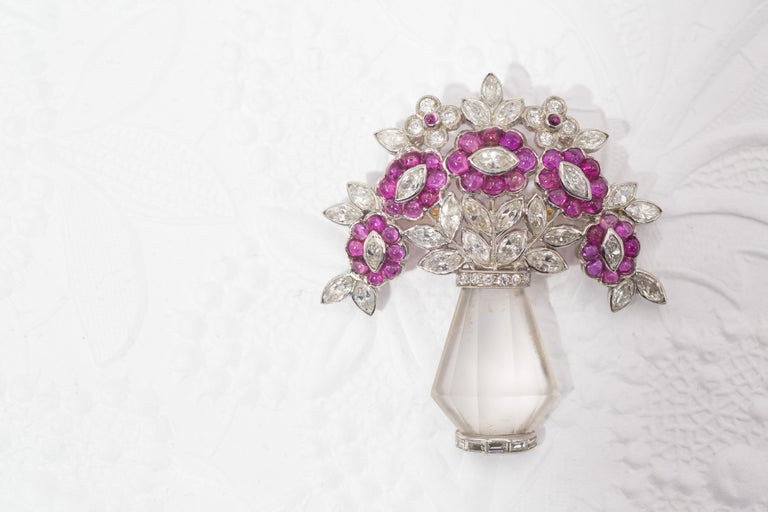 Unique Art Deco brooch from ca. 1930 in the form of a flower bouquet within a crystal vase. Amazingly well hand-crafted and beautifully designed, the brooch has been worked in platinum with Old European cut and old cut marquis shaped diamonds,