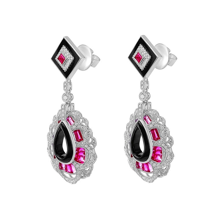 2.64 carats of Ruby and 0.79 carats of Diamond are set with Onyx to assemble together an art deco style earring. The earring can be bought as a stand-alone earring or as a set with the bangle. Please check the bangle as well from our recent