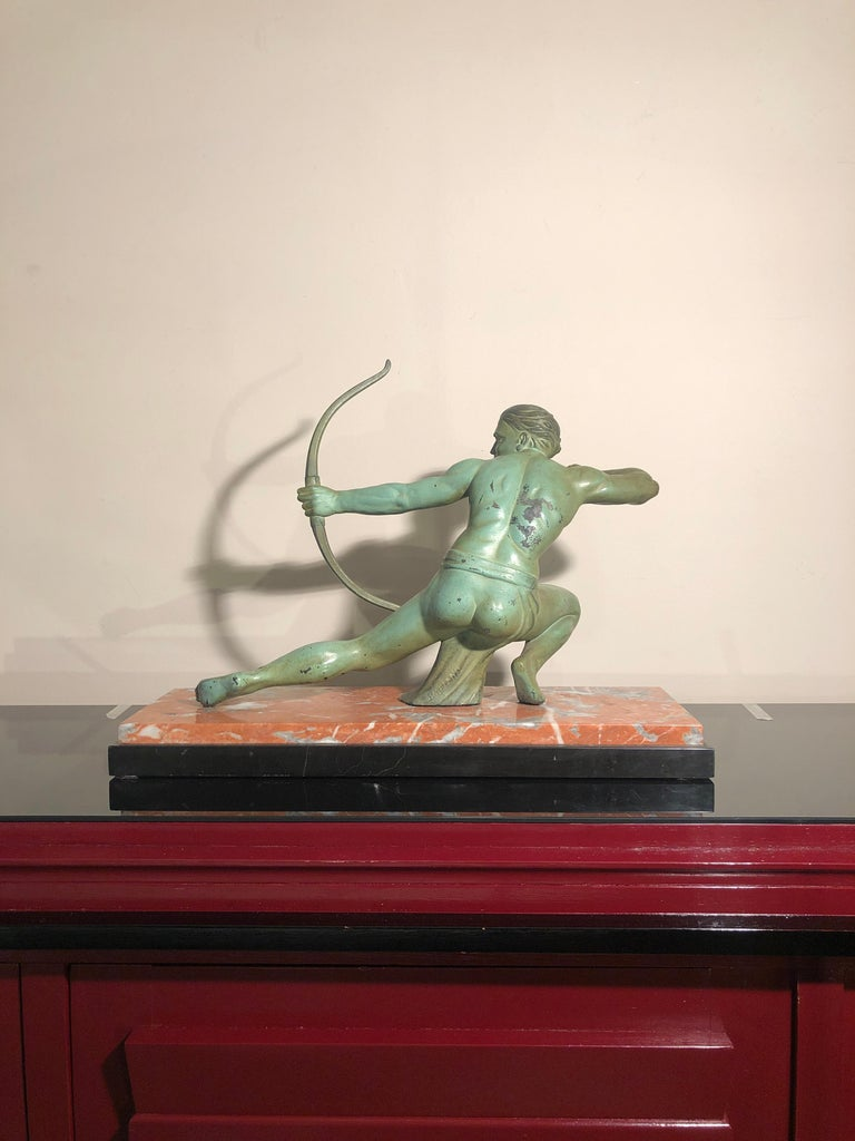 Art Deco Salvatore Melani bowman on marble base figurative sculpture, 1930s A bronze Art Deco sculpture representing a bowman on a marble base. Signed S. Melani. Salvatore Melani was an Italian sculptor active in the first part of 20th century.
