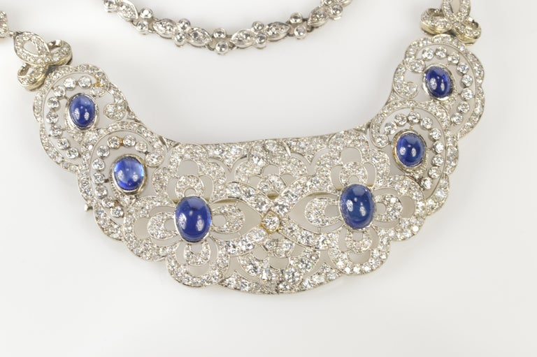 "This beautiful ""bib"" style necklace was most likely a hair comb or hair piece that was at some point was altered by adding a custom styled chain. The base of the necklace is a fantastically styled Art Deco platinum piece with cabochon sapphires and"