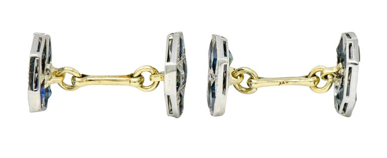 Link style cufflinks terminating as milgrain platinum octagonal forms  Each centering a bead set round brilliant cut diamond, with single cut diamond accents, weighing in total approximatley 0.72 carat; G to I color with VS and SI