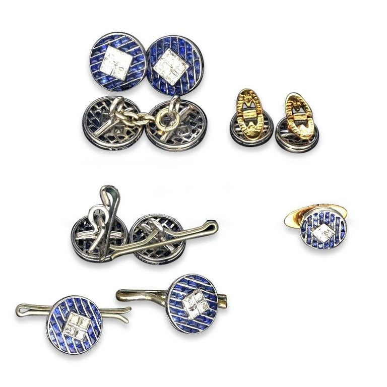 Elegant Art Deco gentleman's dress set by Boucheron c.1925, comprising a pair of double ended chain link cufflinks, four buttons and three studs all finely crafted in platinum, each round face set with rows of calibre-cut buff top sapphires and