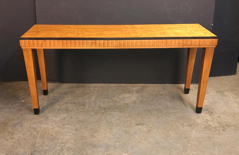 Art Deco satinwood console table with ebonized banded and square tapered legs.