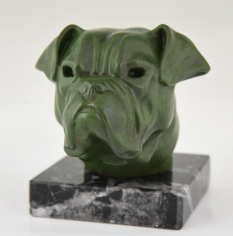 """Art Deco sculpture of a bulldog by Max Le Verrier, France, 1930. Patinated art metal on a marble base.   This model is illustrated as car mascot in the book: """"Mascottes passion"""" by Michel Legrand, Antic show éditions. General information about"""