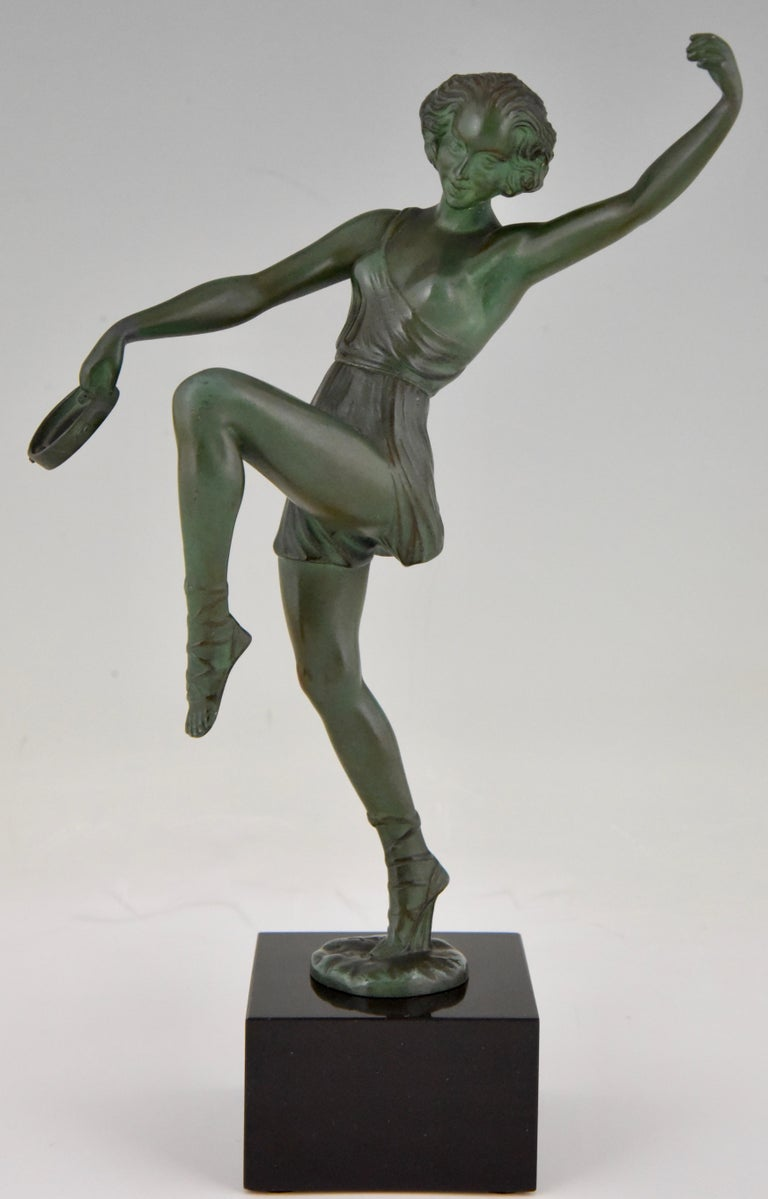 Art Deco sculpture of dancer with tambourine by Fayral, pseudonym of Pierre Le Faguays, France 1930. Patinated Art metal on a Belgian Black marble base.