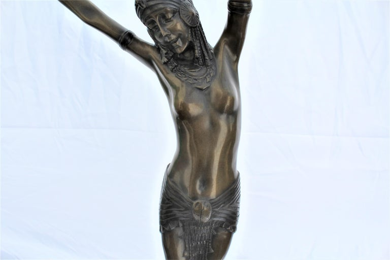 Dance semi-nude Egyptian girl in scarab skirt up on her toes. Mounted on absolute black marble base with an Egyptian bronze polished plaque. Has signature in r/h loe corner. Finely cast and detailed with multi-patina finish.